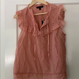 Rose colored frilly blouse